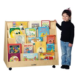 Child standing next to Double-Sided Book Display