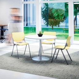Three Energy Series Perforated Back Stack Chairs, Lime Green, at a table