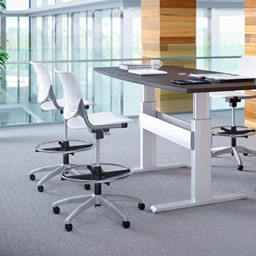 Energy Series Perforated Back Adjustable-Height Drafting Stool w/ out Arms - White in an office setting