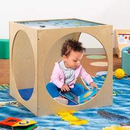 Toddler playing in the Acrylic Top Ocean Play House Cube